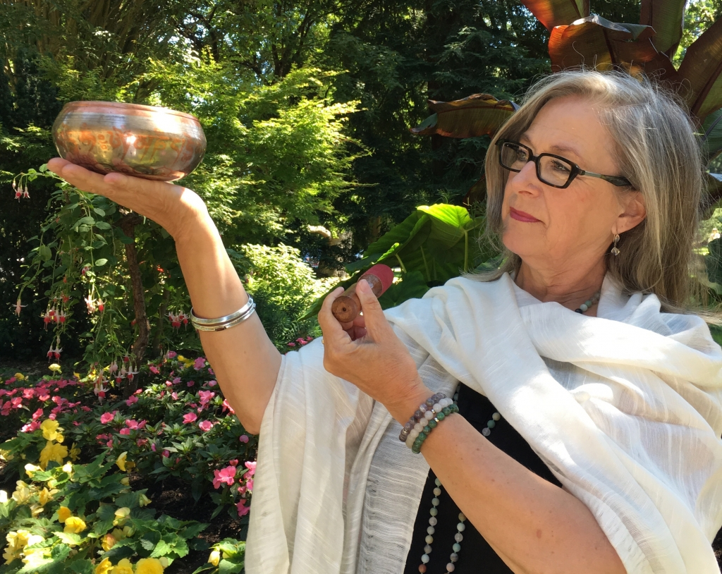 Nancy Crites plays a Tibetan Singing Bowl during a sound healing QiGong session
