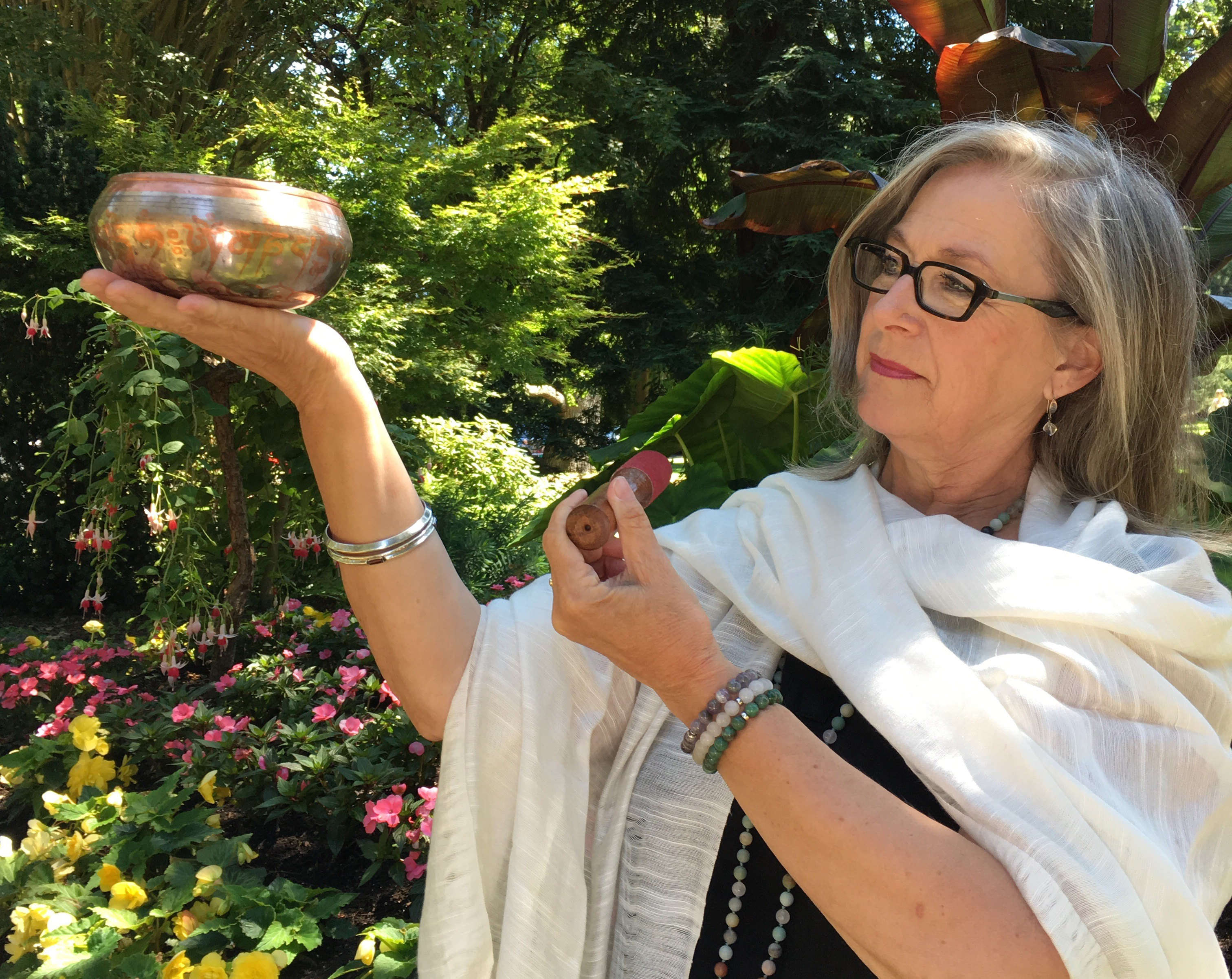 Nancy Crites plays a Tibetan Singing Bowl during one of her QiGong classes